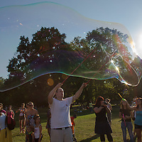 Man blow soap bubbles during a soap bubble day in a public park in Budapest, Hungary on August 19, 2012. ATTILA VOLGYI