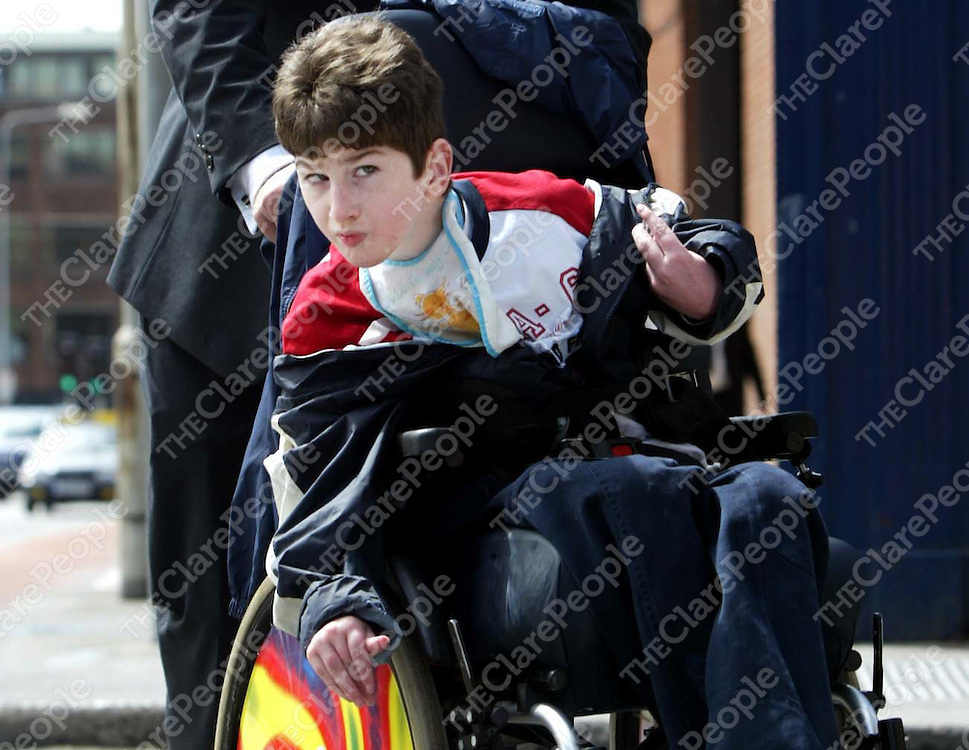 COMBER (PARAIC) : SUING MID WESTERN HEALTH BOARD FOR MEDICAL NEGLIGENCE DURING HIS BIRTH , HIGH COURT , DUBLIN. (5/7/05) **** SEE HIGH COURT STORY<br /> PIC SHOWS: PARAIC COMBER , (12 YRS) , OF MULLAGH , ENNIS , CO CLARE ,WHO  IS SUING THE MID WESTERN HEALTH BOARD - THROUGH HIS MOTHER , DEIRDRE - FOR NEGLIGENCE AND BREACH OF DUTY DURING PARAIC'S BIRTH ,  LEAVING COURT YESTERDAY (TUES) , THE CASE IS SET FOR MENTION ON FRIDAY NEXT.<br /> (PIC: COURTPIX)