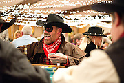 David Henneberry laughs from behind his bank robber mask Saturday night as he deals himself black jack at the 49er Ball. Henneberry volunteers at the Jackson Hole Lions Club fund raiser each year, playing cards for charity to benefit the club's eye care program.
