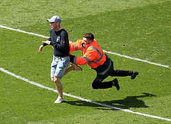 23 April 2017 - EFL Championship Football - Aston Villa v Birmingham City - A steward tackles a pitch invader - Photo: Paul Roberts / Offside