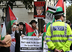 © Licensed to London News Pictures. 09/09/2015. London, UK. Jewish protestors carry Pro-Palestinian placards, one depicting Israeli Prime Minister Benjamin Netanyahu, gather outside the gates of Downing Street ahead of his visit tomorrow.  Photo credit: Peter Macdiarmid/LNP