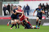 Liam Williams of the Scarlets gets the ball away from a tackle. Guinness Pro12 rugby match, Scarlets v Munster at the Parc y Scarlets in Llanelli, West Wales on Saturday 3rd September 2016.<br /> pic by  Andrew Orchard, Andrew Orchard sports photography.