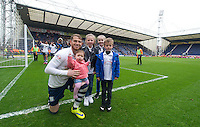 Preston North End's Joe Garner and family pose for the cameras as he and his team-mates do a lap of the pitch after their last home match of the season to applaud their fans for their support through the season<br /> <br /> Photographer Stephen White/CameraSport<br /> <br /> Football - The Football League Sky Bet League One - Preston North End v Swindon Town - Saturday 25th April 2015 - Deepdale - Preston<br /> <br /> © CameraSport - 43 Linden Ave. Countesthorpe. Leicester. England. LE8 5PG - Tel: +44 (0) 116 277 4147 - admin@camerasport.com - www.camerasport.com