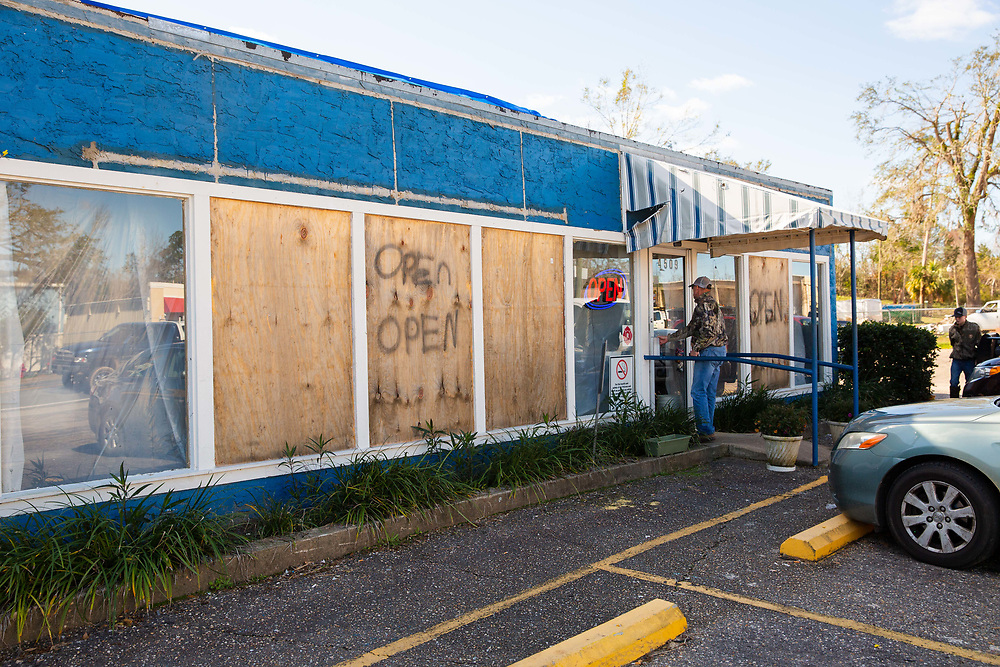 Customers walk into the Waffle Iron in Marianna, Fla., on Saturday, Jan. 5, 2019. The restaurant is still under repair from damage sustained by Hurricane Michael. Photo by Kevin D. Liles for The New York Times