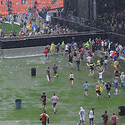 WASHINGTON, DC - July 4, 2015 - Fans run back onto the field to claim their spot after the threat of lightning caused the attendees at the Foo Fighters 20th Anniversary Blowout to seek shelter in the concourses. (Photo by Kyle Gustafson / For The Washington Post)