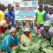 UNDP beneficiaries pose for a photograph at Giwa Resettlement Farm near Nakuru in Kenya's Rift Valley Province.