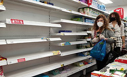 © Licensed to London News Pictures. 26/09/2021. London, UK. Shoppers walk past empty shelves of tissue boxes in Savers in north London as the supply chain crisis continues. UK food producers and supermarkets are warning that shoppers are likely to face product shortages in the coming weeks after thousands of EU nationals quit their jobs as truck drivers in the UK following Brexit. According to the government, 5,000 heavy truck drivers and 5,500 poultry workers will be given working visas until Christmas 2021. Photo credit: Dinendra Haria/LNP