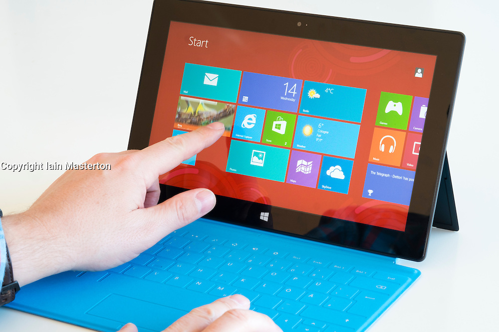 Man using Windows 8 on a Microsoft Surface rt tablet computer