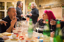 One of the best parts of Italy - the Food! Blue Miller (disguised in red) chatting with Pete at a wonderful dinner at the 12 Apostles Restaurant (in continuous operation with the same name for almost 300 years) during Motor Bike Expo. Verona, Italy. January 23, 2016.  Photography ©2016 Michael Lichter.