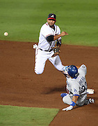 ATLANTA, GA - SEPTEMBER 02:  Shortstop Alex Gonzalez #2 of the Atlanta Braves turns a double play while left fielder Juan Rivera #33 of the Los Angeles Dodgers slides to try to break it up during the game at Turner Field on September 2, 2011 in Atlanta, Georgia.  (Photo by Mike Zarrilli/Getty Images)