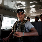 August 09, 2012 - Aleppo, Syria: A group of Free Syria Army (FSA) fighters leave their headquarters in Haneno neighborhood, to join their comrades on the frontline at Salehedine...The Syrian army and the FSA have in the past week exchanged heavy fire in a battle for the control of Syria's economic capital, Aleppo. (Paulo Nunes dos Santos/Polaris)