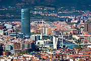 Aerial view of Bilbao Guggenheim Museum, Iberdrola Tower skyscraper and Red Bridge in Basque country, Spain