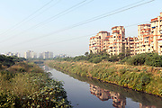 The Najafgarh drain - polluted with effluent and industrial chemicals passes through new housing complexes at Dwarka, New Delhi, India