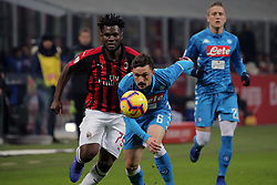 January 26, 2019 - Milan, Milan, Italy - Frank Kessie #79 of AC Milan competes for the ball with Mario Rui #6 of SSC Napoli during the serie A match between AC Milan and SSC Napoli at Stadio Giuseppe Meazza on January 26, 2018 in Milan, Italy. (Credit Image: © Giuseppe Cottini/NurPhoto via ZUMA Press)