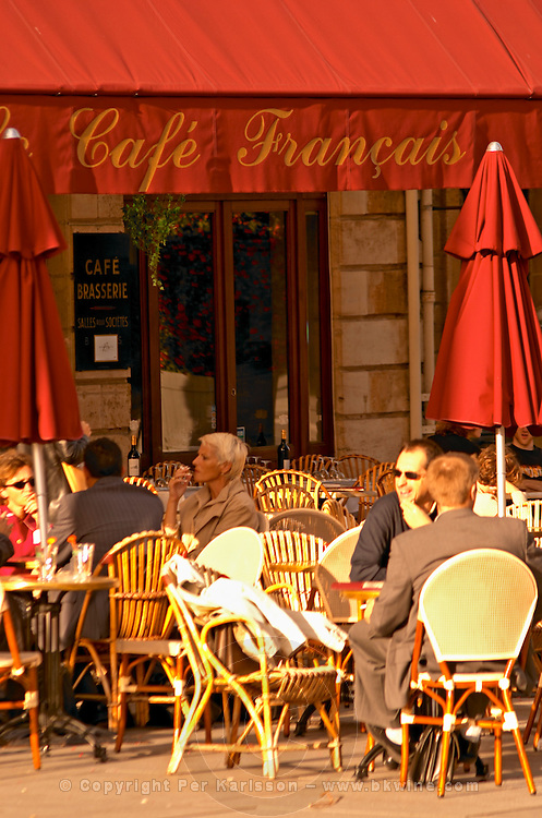 Cafe Francais in Bordeaux with outside seating and people eating and drinking in the evening sun, Place Pey Berland.