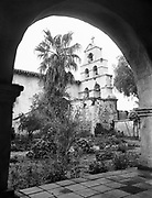 8902-07. Mission San Diego garden and bell wall before the restoration was done in 1930-31.