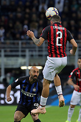 October 21, 2018 - Milan, Milan, Italy - Davide Calabria #2 of AC Milan competes for the ball with Borja Valero #20 of FC Internazionale Milano during the serie A match between FC Internazionale and AC Milan at Stadio Giuseppe Meazza on October 21, 2018 in Milan, Italy. (Credit Image: © Giuseppe Cottini/NurPhoto via ZUMA Press)