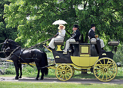 © under license to London News Pictures. WINDSOR, UK  13/05/2011.A carriage and team from The Carriage Marathon. The Royal Windsor Horse Show in the grounds of Windsor Castle today (13 May 2011). Photo credit should read Stephen Simpson/LNP.