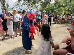 Robert Ba-at rings the gong as Happy Buddha to awaken the Dragon.  It's Chinese New Year at the Nirvana Healing Temple.  29 January 2017.  St. Thomas, USVI.  © Aisha-Zakiya Boyd