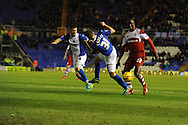 Birmingham City's Paul Caddis © battles with Middlesbrough's Albert Adomah(r) during the Skybet football league championship match, Birmingham city v Middlesbrough at St.Andrew's in Birmingham, England on Sat 7th Dec 2013. pic by Jeff Thomas/Andrew Orchard sports photography.