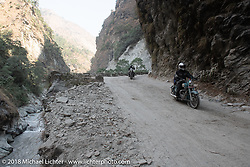 Jonathan Pite riding through a narrow canyon on Day-7 of our Himalayan Heroes adventure riding from Tatopani to Pokhara, Nepal. Monday, November 12, 2018. Photography ©2018 Michael Lichter.
