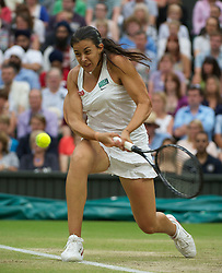 28.06.2011, Wimbledon, London, GBR, WTA Tour, Wimbledon Tennis Championships, im Bild Marion Bartoli (FRA) in action during the Ladies' Singles Quarter-Final match on day eight of the Wimbledon Lawn Tennis Championships at the All England Lawn Tennis and Croquet Club. EXPA Pictures © 2011, PhotoCredit: EXPA/ Propaganda/ David Rawcliffe +++++ ATTENTION - OUT OF ENGLAND/UK +++++ // SPORTIDA PHOTO AGENCY