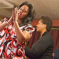 012113       Brian Leddy<br /> Annfuree Fernando claps at sings during a song at the annual Martin Luther King Jr. celebration at St. Paul's Missionary Baptist Church Monday afternoon.  The annual event drew community members from a variety of backgrounds.
