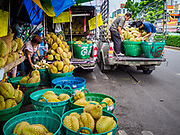 08 JUNE 2017 - BANGKOK, THAILAND: Workers unload durian, a popular Thai fruit, at Khlong Toey Market, Bangkok's main fresh market. Thai consumer confidence dropped for the first time in six months in May following a pair of bombings in Bangkok, low commodity prices paid to farmers and a sharp rise in the value of the Thai Baht versus the US Dollar and the EU Euro. The Baht is surging because of political uncertainty, related to Donald Trump, in the US and Europe. The Baht's rise is being blamed for a drop in Thai exports. This week the Baht has been trading at around 33.90 Baht to $1US, it's highest point in two years.      PHOTO BY JACK KURTZ