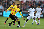 Etienne Capoue of Watford (l) looks to play the ball past Modou Barrow of Swansea city. .Premier league match, Swansea city v Watford at the Liberty Stadium in Swansea, South Wales on Saturday 22nd October 2016.<br /> pic by  Andrew Orchard, Andrew Orchard sports photography.