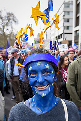 "© Licensed to London News Pictures. 23/03/2019. LONDON, UK. A woman wearing facepaint joins thousands of people in the ""Put It To The People March"", marching from Park Lane to Parliament Square on what was supposed to be six days before the UK was due to leave the EU, before an extension to the departure date was given.  Protesters demand that the public is given a final say on Brexit as support for the Prime Minister's withdrawal plan continues to recede.  Photo credit: Stephen Chung/LNP"