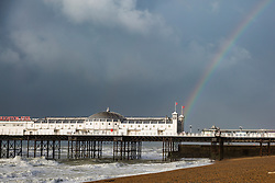 © Licensed to London News Pictures. 21/10/2017. Brighton, UK. A rainbow hangs over Brighton palace pier as powerful gusts of wind and rain are hitting Brighton and Hove as storm Brian hits the South Coast. Photo credit: Hugo Michiels/LNP