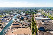 Nederland, Utrecht, Utrecht, 13-05-2019; Bedrijventerrein Lage Weide met links het Uraniumkanaal, rechts Atoomweg, geheel rechts rijksweg A2. Links Demka-spoorbrug over Amsterdam-Rijnkanaal. Boven het midden, binnnestad van Utrecht.<br /> Business park nortwest of Utrecht (at the horizon).<br /> luchtfoto (toeslag op standard tarieven);<br /> aerial photo (additional fee required);<br /> copyright foto/photo Siebe Swart