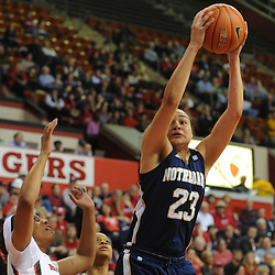 Notre Dame Fighting Irish guard Kayla McBride (23) grabs an offensive rebound during first half NCAA Big East women's basketball action between Notre Dame and Rutgers at the Louis Brown Athletic Center. Notre Dame leads 40-23 at halftime.