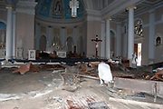 A survivor of hurricane Katrina in Bay St. Lois neals and prays in the St. Stanislaus church that was flooded from the storm Wed, Sept. 1,2005. bay St. Louis was on of the hardes hit coast line The church is still standing all the pews were washed out with the storm but all the statues were spared as well as the stained glass windows the school ans churcha re landmanrks and surived camille.(photo/Suzi Altman)