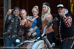 A group of friends come in to have some fun at the Iron Horse Saloon for the final David Allan Coe concert during Daytona Beach Bike Week, FL, USA. Sunday, March 15, 2015.  Photography ©2015 Michael Lichter.