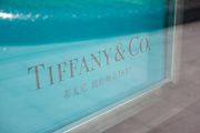 Tiffany & Co. sign in Chinese and English text in the heart of Shanghais exclusive shopping district in Shanghai, China. Many of the Worlds major brands have arrived in China, and in particularly Chinas money capital, Shanghai. This part of Nanjing Rd is where the citys rich and famous come to shop.