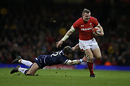 Hadleigh Parkes of Wales breaks past a tackle from Pete Horne of Scotland as he runs in to set up a try for Steff Evans of Wales. Wales v Scotland, NatWest 6 nations 2018 championship match at the Principality Stadium in Cardiff , South Wales on Saturday 3rd February 2018.<br /> pic by Andrew Orchard, Andrew Orchard sports photography