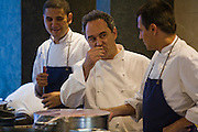 Ferran Adrià, chef of El Bulli restaurant near Rosas on the Costa Brava in Northern Spain tastes  food in the restaurant's kitchen. (Ferran Adrià is featured in the book What I Eat: Around the World in 80 Diets.)