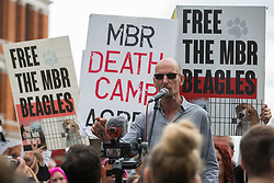 London, UK. 28th August, 2021. A Camp Beagle activist addresses fellow animal rights activists from Animal Rebellion during a National Animal Rights March. Camp Beagle is calling for the release of beagle dogs reared for animal research from MBR Acres in Huntingdon. Animal Rebellion is an offshoot of Extinction Rebellion and organised the march for the sixth day of Extinction Rebellion's Impossible Rebellion protests in London.