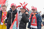 Young group of Liverpool fans cheering outside Wembley Stadium before k/o. The FA Cup, semi final match, Aston Villa v Liverpool at Wembley Stadium in London on Sunday 19th April 2015.<br /> pic by John Patrick Fletcher, Andrew Orchard sports photography.