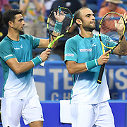 ROBERT FARAH and JUAN SEBASTION CABAL celebrate a victory at the Rock Creek Tennis Center.