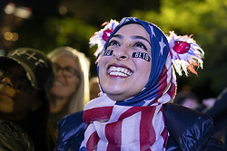 March 30, 2019 - Austin, Texas, U.S. - Muna Hussaini of Austin listens as former congressman Beto O'Rourke of El Paso kicks off his presidential campaign at a late night rally in front of the Texas Capitol. O'Rourke is in the top tier of a crowded field of Democratic candidates to challenge President Donald Trump. (Credit Image: © Bob Daemmrich/ZUMA Wire)