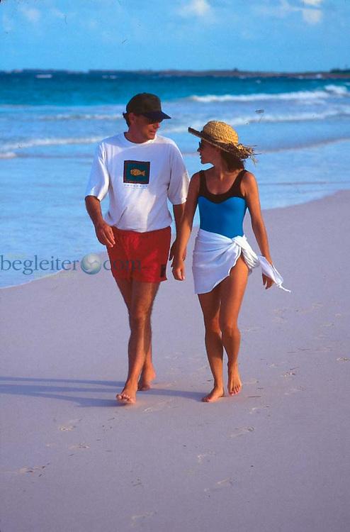 Couple on a sandy beach in the Bahamas, Harbor Island