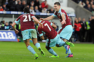 Burnley's Andre Gray (7) runs to celebrate after scoring their second goal with team mates Sam Vokes (r) and George Boyd (21). Premier league match, Swansea city v Burnley at the Liberty Stadium in Swansea, South Wales on Saturday 4th March 2017.<br /> pic by  Carl Robertson, Andrew Orchard sports photography.