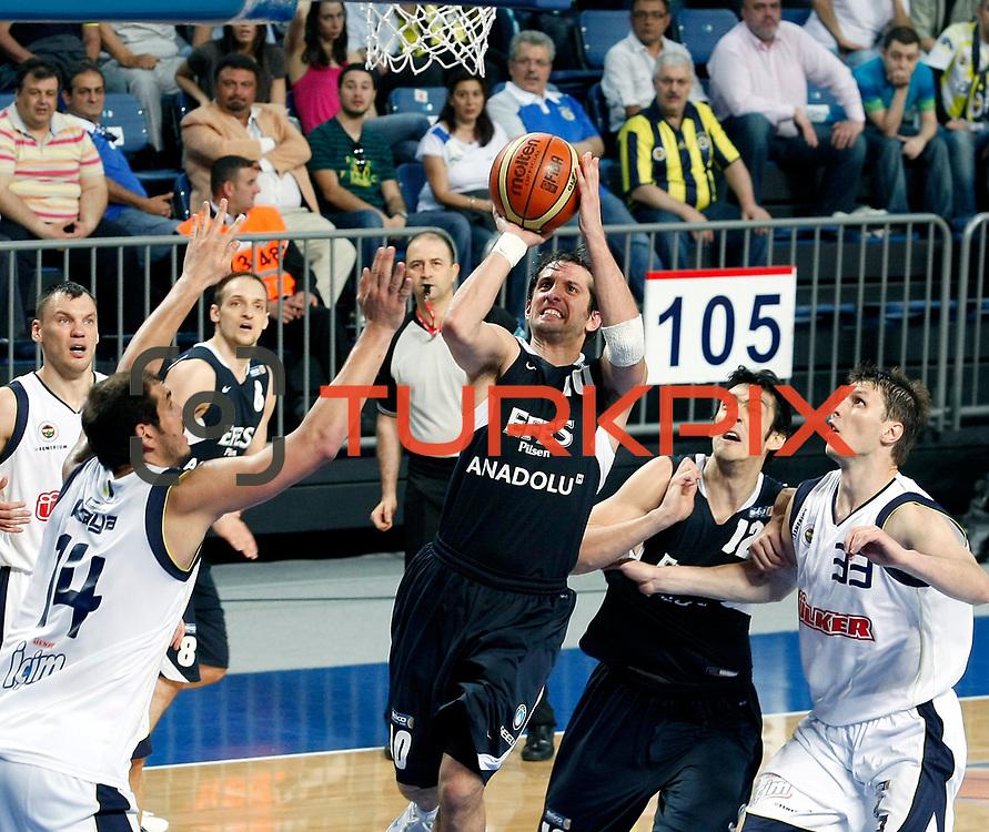 Fenerbahce's Marko TOMAS (R) and Efes Pilsen's Kerem TUNCERI (C), Kerem GONLUM (2ndR) during their Turkish Basketball Legague Play-Off semi final first match Fenerbahce between Efes Pilsen at the Sinan Erdem Arena in Istanbul Turkey on Tuesday 24 May 2011. Photo by TURKPIX