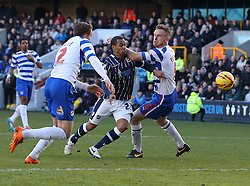 Millwall's DJ Cambell proves a menace as he tries to force his way through the defence - Photo mandatory by-line: Robin White/JMP - Tel: Mobile: 07966 386802 01/02/2014 - SPORT - FOOTBALL - The Den - Millwall - Millwall v Reading - Sky Bet Championship