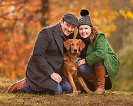A couple and their golden retriever puppy in Prospect Park