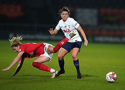 Tottenham Hotspur's Esther Morgan (right) and Charlton Athletic's Lois Heuchan (left) battle for the ball during the FA Women's League Cup Group C match at The Hive Stadium, London. Picture date: Wednesday October 13, 2021.