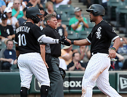August 21, 2017 - Chicago, IL, USA - Left, Chicago White Sox second baseman Yoan Moncada (10), and right, Chicago White Sox first baseman Jose Abreu (79), celebrate after scoring on the single by Chicago White Sox right fielder Avisail Garcia (26) during the first inning against the Minnesota Twins on Monday, Aug. 21, 2017 at Guaranteed Rate Field in Chicago, Ill. (Credit Image: © Nuccio Dinuzzo/TNS via ZUMA Wire)