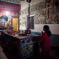 A woman, wearing auspicious red, prays at the altar of a Mazu temple. <br /> <br /> In recent years, there has been a perceived shift in government opinion about folk religion from benign neglect to active favor. Some believe this shift is due to the rise of Christianity as China's fastest growing religion, particularly in rural areas. Religious anthropologists who study conversion rates found that in those Chinese societies, such as in Taiwan and Hong Kong, who have a deep unbroken tradition of folk religion are less like to convert to Christianity.